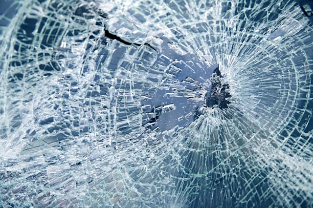 close up broken car windshield. ...