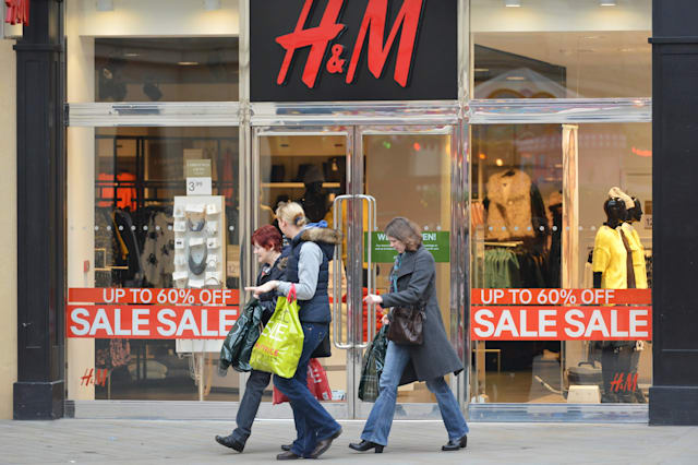 BATH - DEC 26: People walk past a H&M store in Southgate shopping district for the Boxing Day Sales on Dec 26, 2014 in Bath, UK.