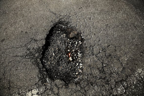 Harsh Winter Creates High Number Of Potholes On New York City's Roads