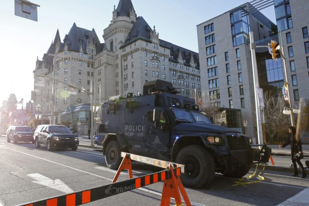 A Royal Canadian Mounted Police vehicle passes the Fairmont Chateau Laurier as it leaves a secure area...