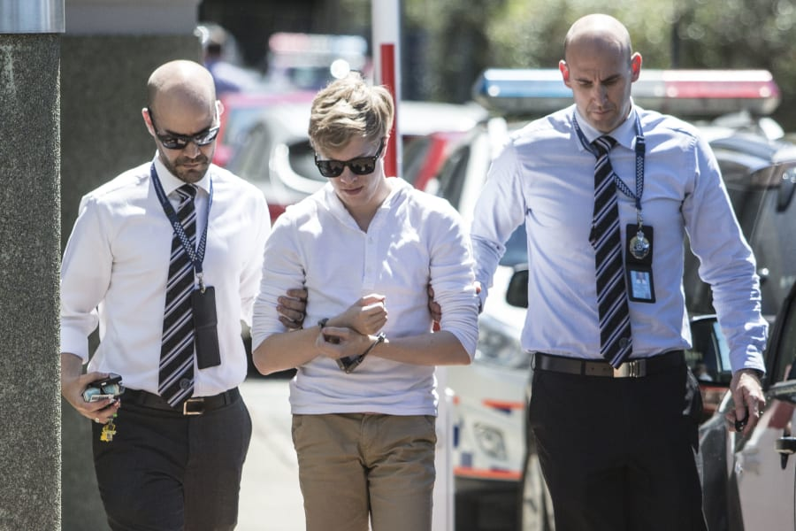 Suspects in the Tiahleigh Palmer murder investigation arrive under arrest at Logan Police Station on...