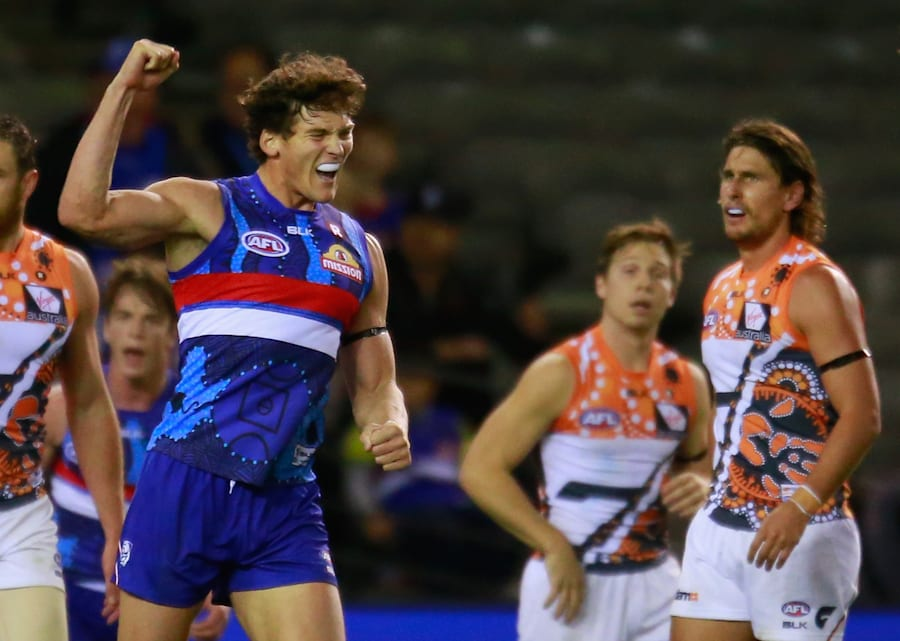Will Minson of the Bulldogs celebrates. Ryan Griffen of the Giants -- another former Bulldog -- does