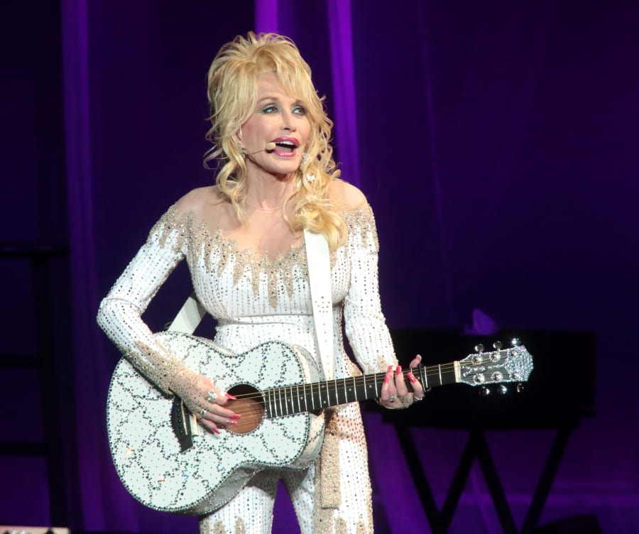 Happy customer: Dolly Parton has no regrets over her breast