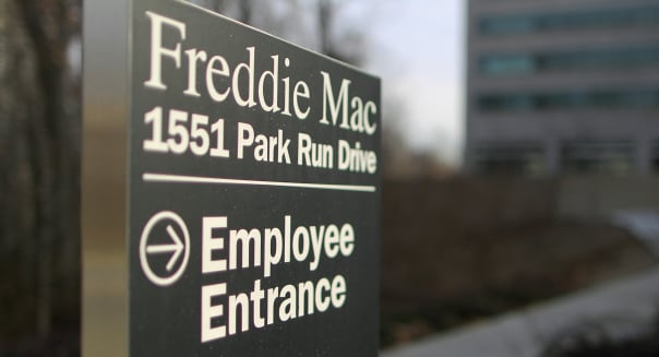 A Freddie Mac signs stands on the grounds of the company's headquarters in McLean, Virginia, U.S., on Thursday, Dec. 30, 2010. Mortgage rates for U.S. loans climbed to a seven-month high, increasing borrowing costs for homebuyers in a sluggish real estate market. Photographer: Andrew Harrer/Bloomberg via Getty Images