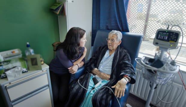 social worker visit sick old...