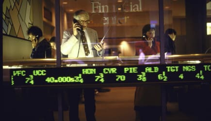 Investors talking on phone to brokers, t
