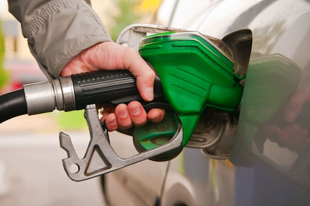 male hand refilling the car with fuel on a filling station