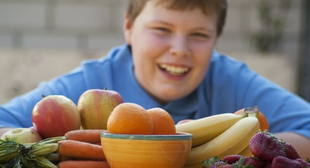 Young overweight child learning the values of healthy eating.