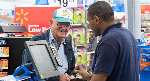 Male African American cashier helps male Anglo senior citizen at new Wal-Mart store in Austin, Texas ©Marjorie Kamys Cotera