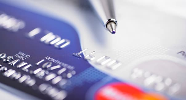 BXHW0J Close up a credit card and pen lower your credit card interest rate Close, up, a, credit, card, and, pen nobody finances
