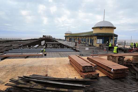 File photo dated 19/02/14 of building materials at Hastings Pier in East Sussex, as more than �470,000 in shares in the fire-ravaged seaside pier have been sold so far to help fund its long-awaited restoration. PRESS ASSOCIATION Photo. Issue date: Thursday April 3, 2014. Organisers behind the revival of Hastings Pier in East Sussex hope to hit their �500,000 target before the share-buying deadline ends on Saturday. See PA story HERITAGE Pier. Photo credit should read: Gareth Fuller/PA Wire