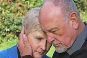 senior man comforting beautiful ...