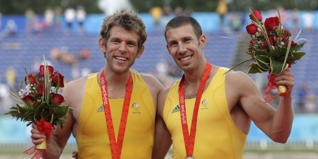 That's Kim's husband Scott Brennan (right) with David Crawshay after winning gold in double sculls in...