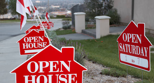 red and white open house sign...