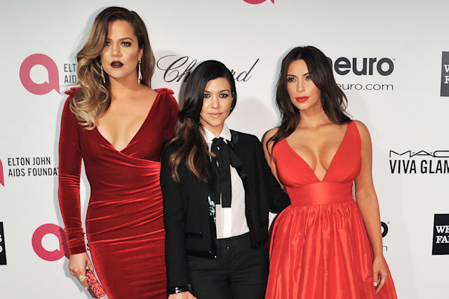 Khloe Kardashian, from left, Kourtney Kardashian, and Kim Kardashian arrive at 2014 Elton John Oscar Viewing and After Party Mar