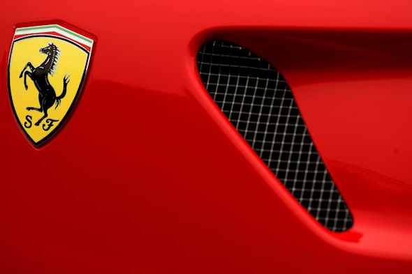 File photo dated 16/03/11 of a Ferrari badge on a car as the Italian supercar company raced to a record year in 2013 on the back of expanding UK sales. PRESS ASSOCIATION Photo. Issue date: Wednesday February 19, 2014. The company made an all-time high net profit of 264 million euros (?217 million) - a 5.4% rise on 2012. A total of 677 Ferraris were sold in the UK, with the nation overtaking Germany as the company's strongest European market. See PA story TRANSPORT Ferrari. Photo credit should read: Dave Thompson/PA Wire