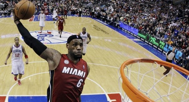 Quick Hits Basketball (FILE - In this March 13, 2013, file photo, Miami Heat's LeBron James goes up for a dunk in the first half