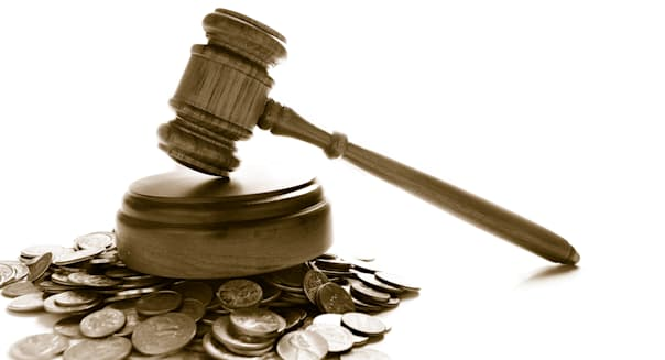 judges law gavel on a pile of...