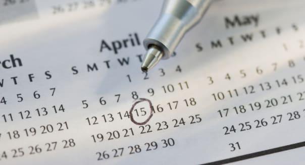 Close up of pen and calendar