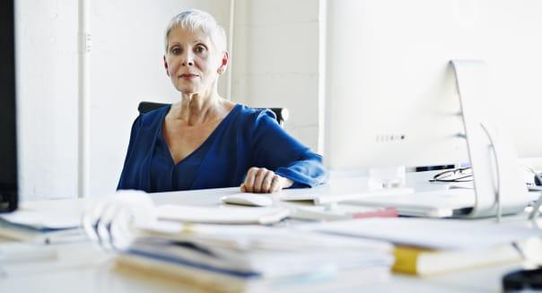 Businesswoman sitting at desk in office portrait