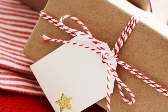 Handmade present boxes with tags on red napkins