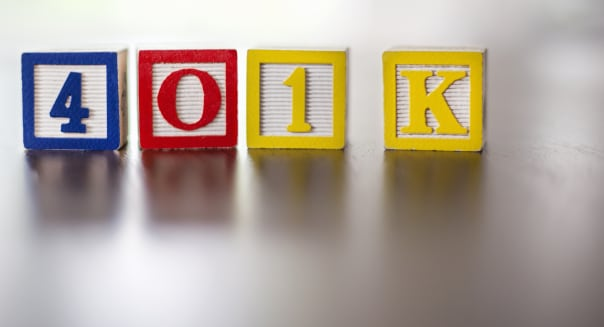 '401 K' spelled out with alphabet blocks