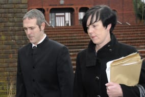 Stewart Sutherland and his wife Natasha, leave Telford Magistrates' Court in Shropshire, after they were fined ?630 and ordered to pay ?300 in costs, for taking their three children out of school to go on a week-long holiday to Greece. PRESS ASSOCIATION Photo. Picture date: Wednesday January 15, 2014. Sutherland, from Trench, Telford, and his spouse both admitted failing to ensure their children, aged 15, 11, and six, attended school regularly between September 4 and October 25 last year. See PA story COURTS Holiday. Photo credit should read: PA Wire