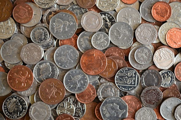 File photo dated 06/02/14 of a collection of coins as the taxman is seeing employers trying to make up