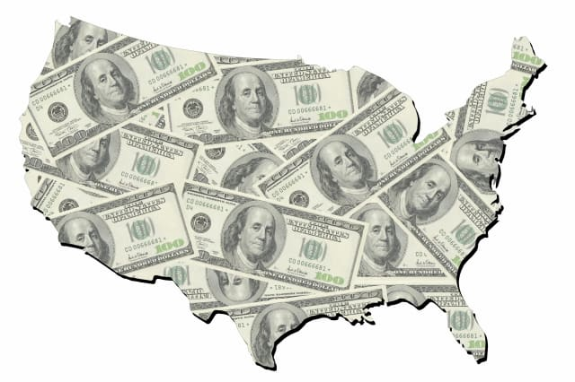 map of united states with random one hundred dollars bills
