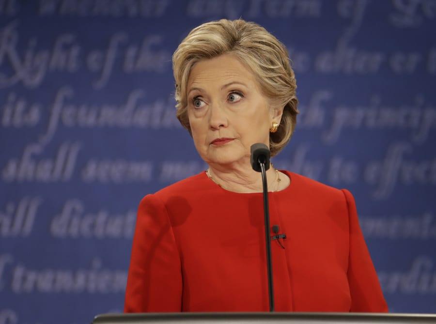 Democratic presidential nominee Hillary Clinton listens to Republican presidential nominee Donald Trump...