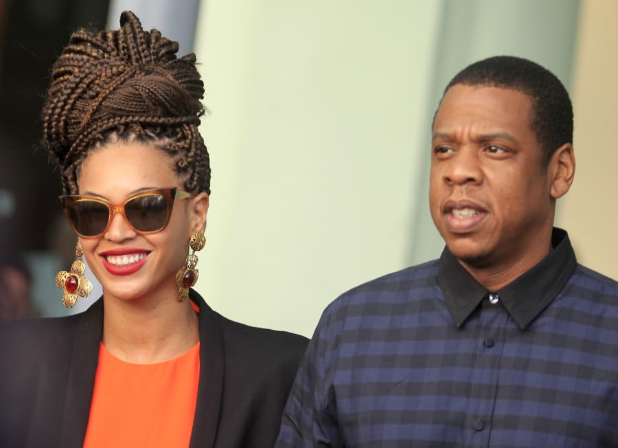 U.S. singer Beyonce (L) and her husband rapper Jay-Z walk as they leave their hotel in Havana April 4,...