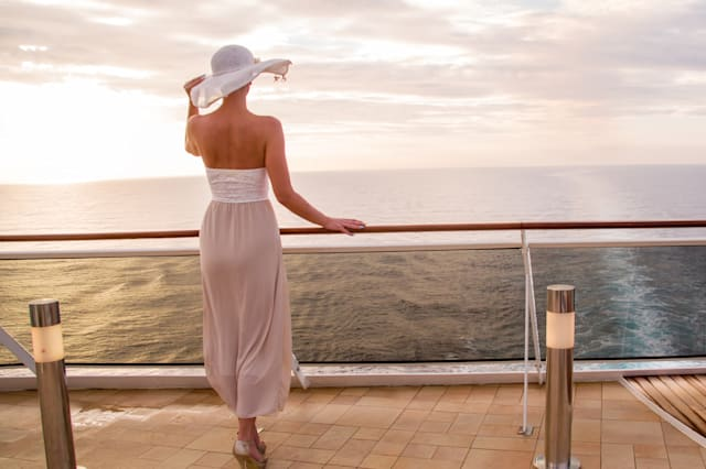 Female looking at sea while standing in cruise