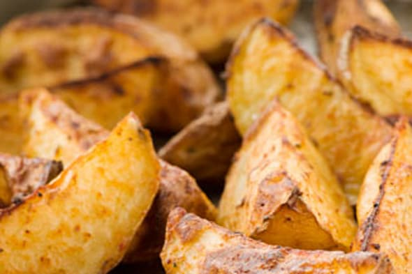 B6009P Tray of Spiced Potato SkinsKeywords  :  	american, food, potato, wedges, baked, spice, snacks