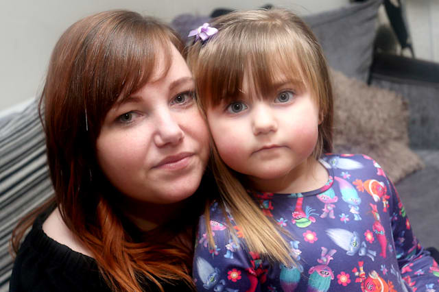 """(L- R) Tammy Dundon, 26 and her daughter Sophia Wood, 3, pictured at home in Bulwell.  An angry mum says her daughter could have died after finding a battery inside a chocolate Easter bunny.  See NTI story NTIBUNNY.  The Co-op is now recalling its own-brand hollow milk chocolate Easter bunny foil figures after an alleged tampering incident in Nottingham.  The National Crime Agency has also stepped in following the scare, as the Co-op says it is a """"criminal matter"""".  Tammy-Louise Dundon from Bulwell, Nottingham, bought one of the £1 treats from the branch in Arnold Road, Bestwood, on Saturday, for her three-year-old daughter Sophia Wood.  She says the youngster bit the ears off the rabbit, only to find a single-cell battery, similar to those found in hearing aids, inside the hollow rabbit.  It comes after a similar incident at Christmas, which resulted in chocolate Santas being recalled due to batteries being found inside the products."""
