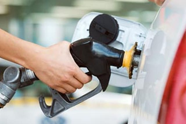 automobile|car|energy|filling station|gas|gas pump|gas station|gasoline|one person only|outdoor|petrol|petrol pump|petrol statio