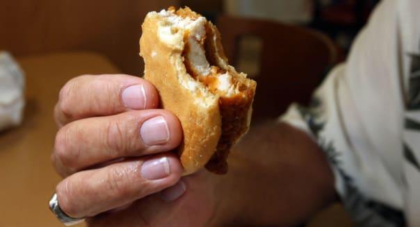 032210 (Allen Eyestone / The Palm Beach Post)  WEST PALM BEACH, FL ..  A customer taste tests the new spicy chicken sandwich fro