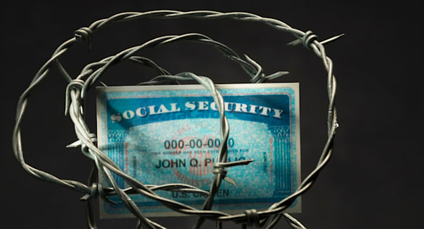 BJDF1E Social security card surrounded by barbed wire. Barbed; Wire; Identity; Theft; In; Studio; Information; No; People; Studi