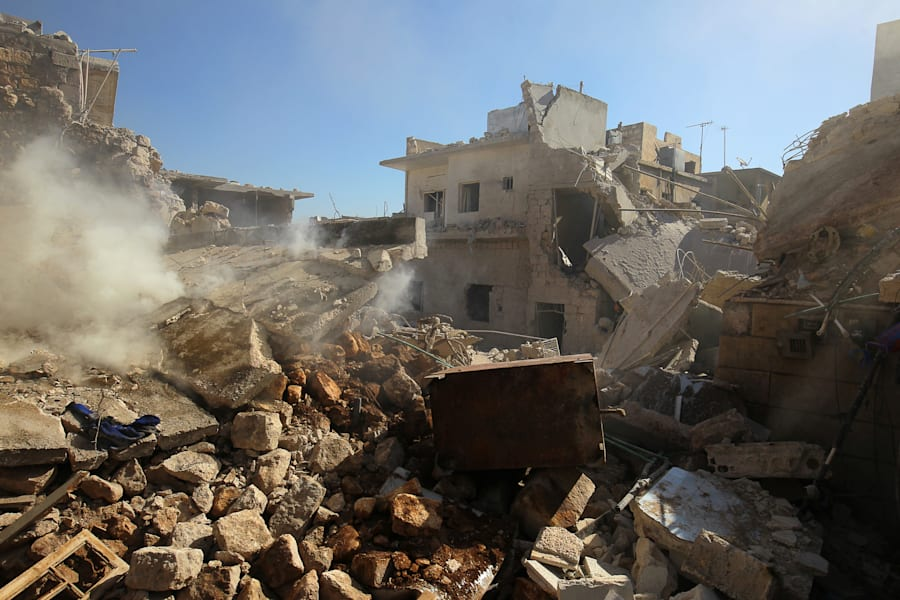 Smoke rises from damaged buildings after an airstrike on the rebel-held town of Darat Izza, province...