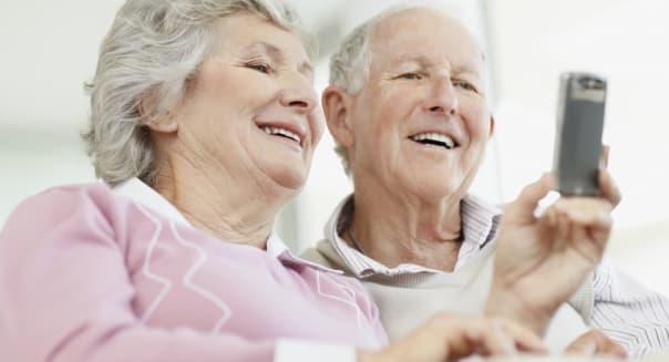 Senior couple reading text message