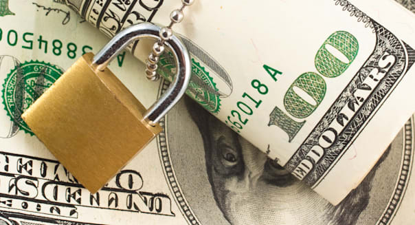 Dollars with padlock isolated on another dollars