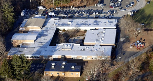 School Shooting Demolition (FILE - This Dec. 14, 2012 aerial file photo shows Sandy Hook Elementary School in Newtown, Conn. Con