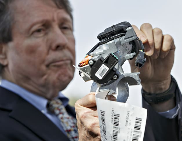 Clarence Ditlow of Center for Automotive Safety holds up GM ignition switch