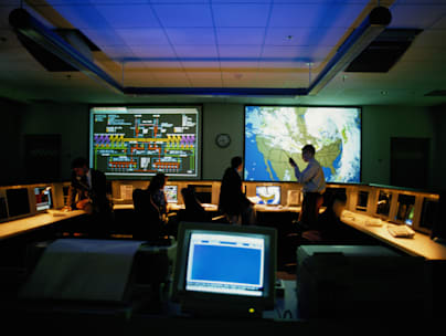 Meteorologists in a Weather Monitoring Room