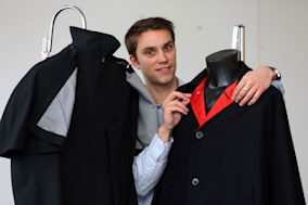 Auctioneer Paul Fairweather with jackets worn by George Harrison (right) and Ringo Starr on the cover of the Beatles  album 'Help!' that are expected to be sold for around ?50,000 when auctioned by Omega Auctions in Stockport. PRESS ASSOCIATION Photo. Picture date: Monday February 10, 2014. See PA story SALE Beatles. Photo credit should read: Dave Thompson/PA Wire