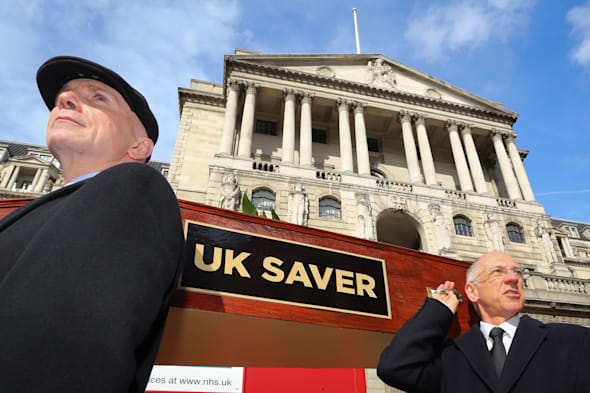 Campaigners from the group Save our Savers carry a coffin as they mourn the passing of the UK Saver outside the Bank of England in London, ahead of today's decision on interest rates and quantitive easing. PRESS ASSOCIATION Photo. Picture date: Thursday March 6, 2014. See PA story ECONOMY Rates Procession. Photo credit should read: Gareth Fuller/PA Wire