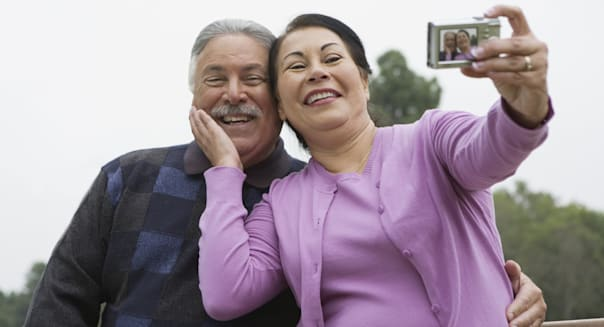 Smiling couple taking picture