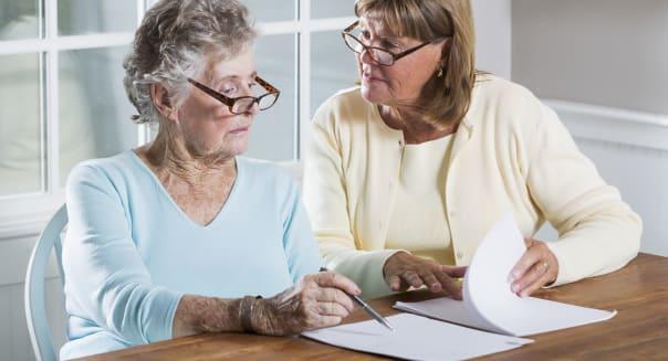Elderly woman reading paperwork