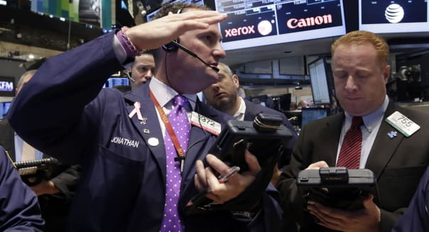 APTOPIX Wall Street (Jonathan Corpina, left, talks with fellow trader Dan Ryan on the floor of the New York Stock Exchange, Frid