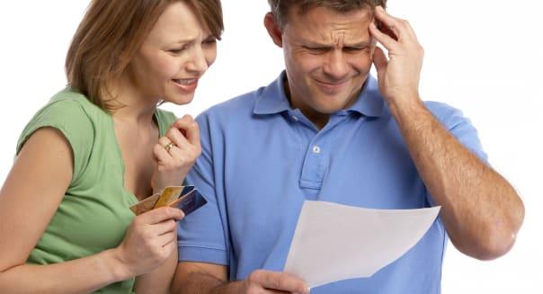 Couple looking at credit card bill