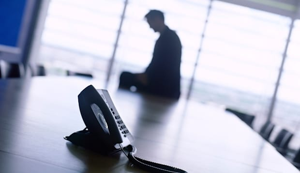 C0X0TN phone and office personnel  phone; business; office; conference; waiting; call; ring; call; modern; suit; man; boardroom;